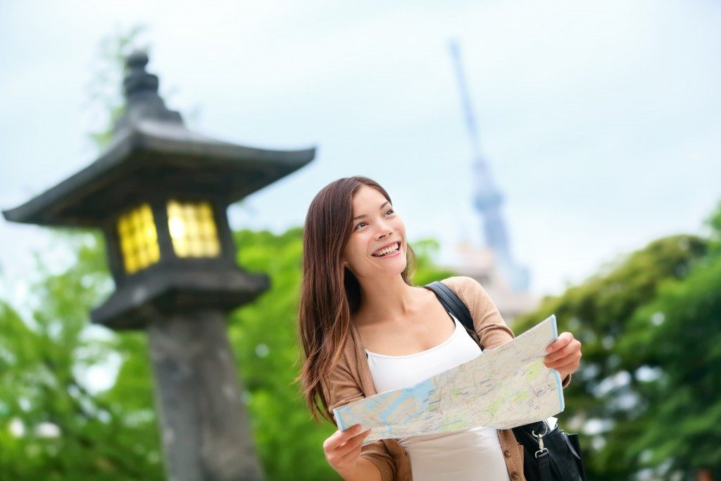 Happy woman holding a map