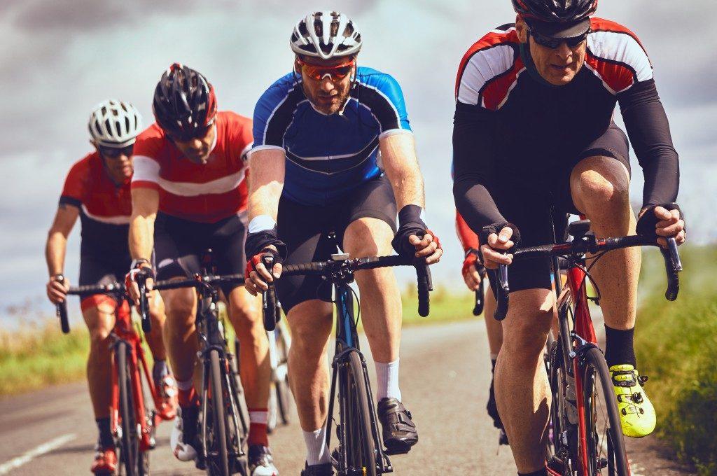 men cycling racing