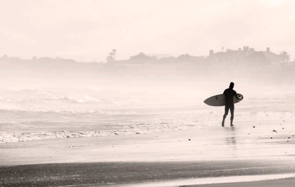 Surfer heading into the mist
