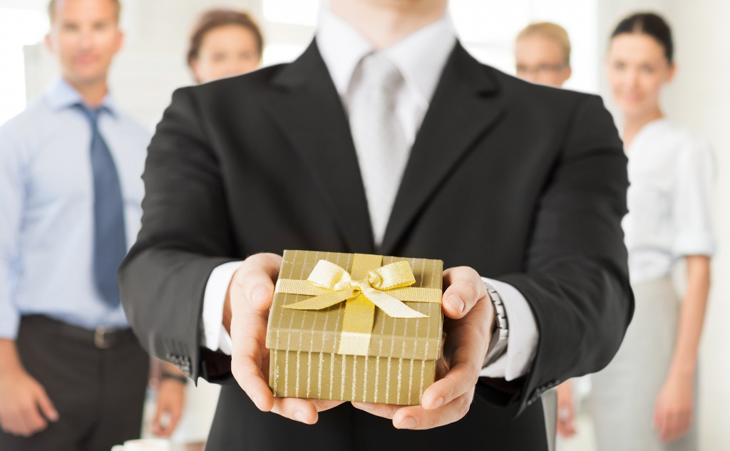 man giving a gift box