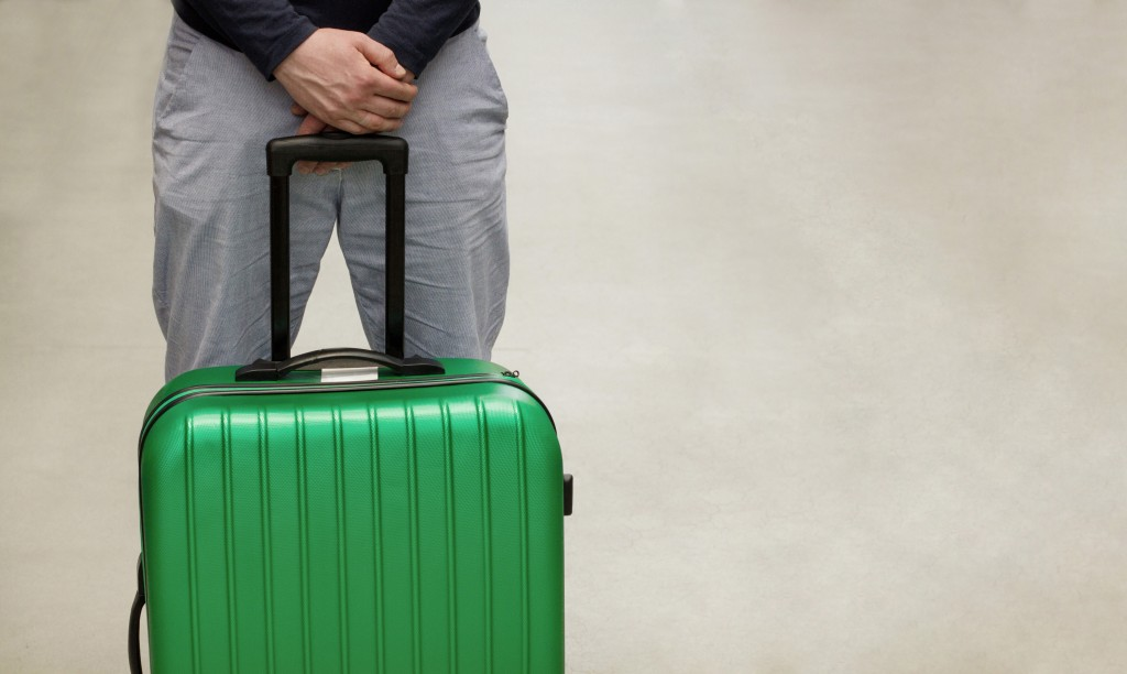 man with green luggage